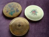 James Kaylor Compacts, the one with writing is 1940s, the plain one 1950s and the one with flowers 1960s